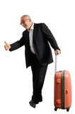 Happy businessman hitch hiking Royalty Free Stock Images
