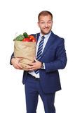 Happy businessman hold bag with healthy food, grocery buyer isolated Stock Photo