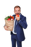 Happy businessman hold bag with healthy food, grocery buyer isolated Royalty Free Stock Image