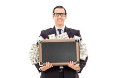 Happy businessman holding a bag full of cash. Isolated on white background Royalty Free Stock Photography