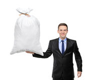 A happy businessman holding a bag with money. Isolated against white background Stock Image