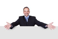 Happy Businessman Holding Blank Billboard Stock Images