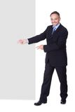 Happy Businessman Holding Blank Billboard Royalty Free Stock Photos