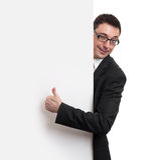Happy Businessman Holding Blank Billboard Stock Image