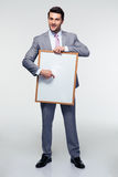 Happy businessman holding blank board Royalty Free Stock Images