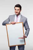 Happy businessman holding blank board Stock Image