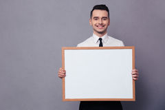 Happy businessman holding blank board Royalty Free Stock Photography