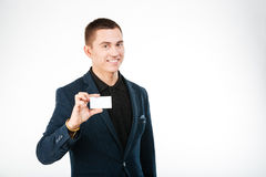 Happy businessman holding blank card Stock Images
