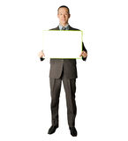 Happy businessman holding blank white card. In his hands Stock Images