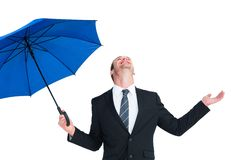 Happy businessman holding blue umbrella and looking up Royalty Free Stock Photography