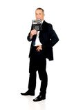 Happy businessman holding a calculator Stock Images
