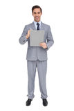 Happy businessman holding a clipboard Stock Image