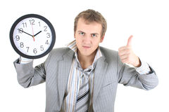 Happy businessman holding a clock Stock Photography