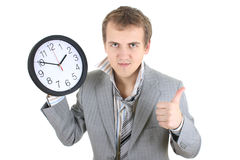 Happy businessman holding a clock Stock Image