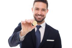 Happy businessman holding coin template isolated on white Stock Photography