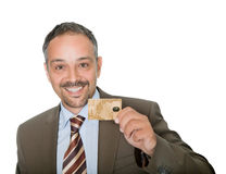 Happy businessman holding a credit crad Royalty Free Stock Image