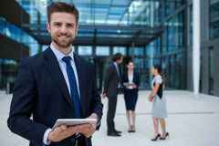 Happy businessman holding digital tablet Royalty Free Stock Images