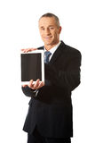Happy businessman holding digital tablet Royalty Free Stock Photos
