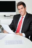 Happy Businessman Holding Document Royalty Free Stock Photo