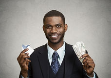 Happy businessman holding dollar, euro bills. Closeup portrait happy, smiling business man, company employee standing, holding dollar, euro bills in hands Royalty Free Stock Images