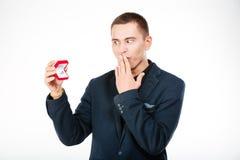 Happy businessman holding engagement ring Royalty Free Stock Image