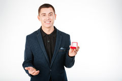 Happy businessman holding engagement ring Stock Photo