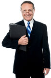 Happy businessman holding files Stock Photography
