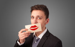Happy businessman holding funny white card on his mouth Royalty Free Stock Photo