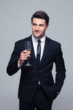 Happy businessman holding glass of champagne Stock Images