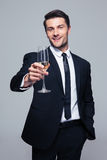 Happy businessman holding glass of champagne Stock Photos