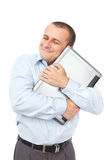 Happy businessman holding his laptop Royalty Free Stock Photo