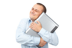 Happy businessman holding his laptop Royalty Free Stock Images