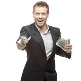Happy businessman holding money Royalty Free Stock Photos