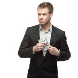 Happy businessman holding money Stock Images