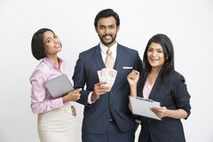 Happy businessman holding money standing with his colleague Stock Photo