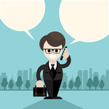 Happy businessman holding phone and talking Royalty Free Stock Photo