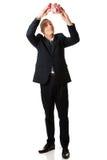 Happy businessman holding piggybank. Smiling mature businessman holding piggybank Stock Image