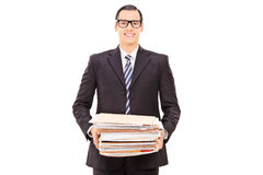 Happy businessman holding a pile of paperwork Stock Image