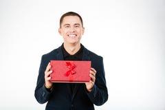 Happy businessman holding present box Stock Photography