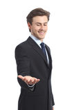 Happy businessman holding something or a blank product. Isolated on a white background royalty free stock photos