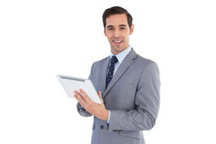 Happy businessman holding a tablet pc Stock Image
