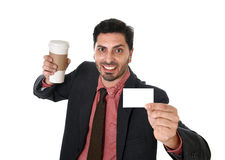 Happy businessman holding take away coffee cup and white card in blank as copy space Stock Photo