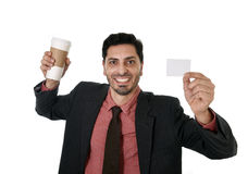 Happy businessman holding take away coffee cup and white card in blank as copy space Stock Photography