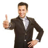 Happy businessman holding thumbs up Royalty Free Stock Images