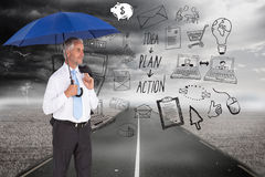 Happy businessman holding umbrella Stock Images