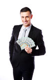 Happy businessman holding US dollars Royalty Free Stock Photo