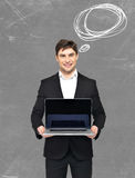Happy businessman holds the  laptop Stock Photo