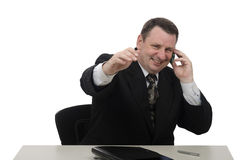Happy businessman holds on mobile phone Royalty Free Stock Photos