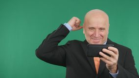 Happy Businessman Image Talk Cell Phone Financial Good News and Make Victory Han.  royalty free stock photography