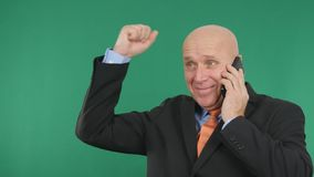 Happy Businessman Image Talk Cell Phone Financial Good News and Make Victory Han.  stock photos